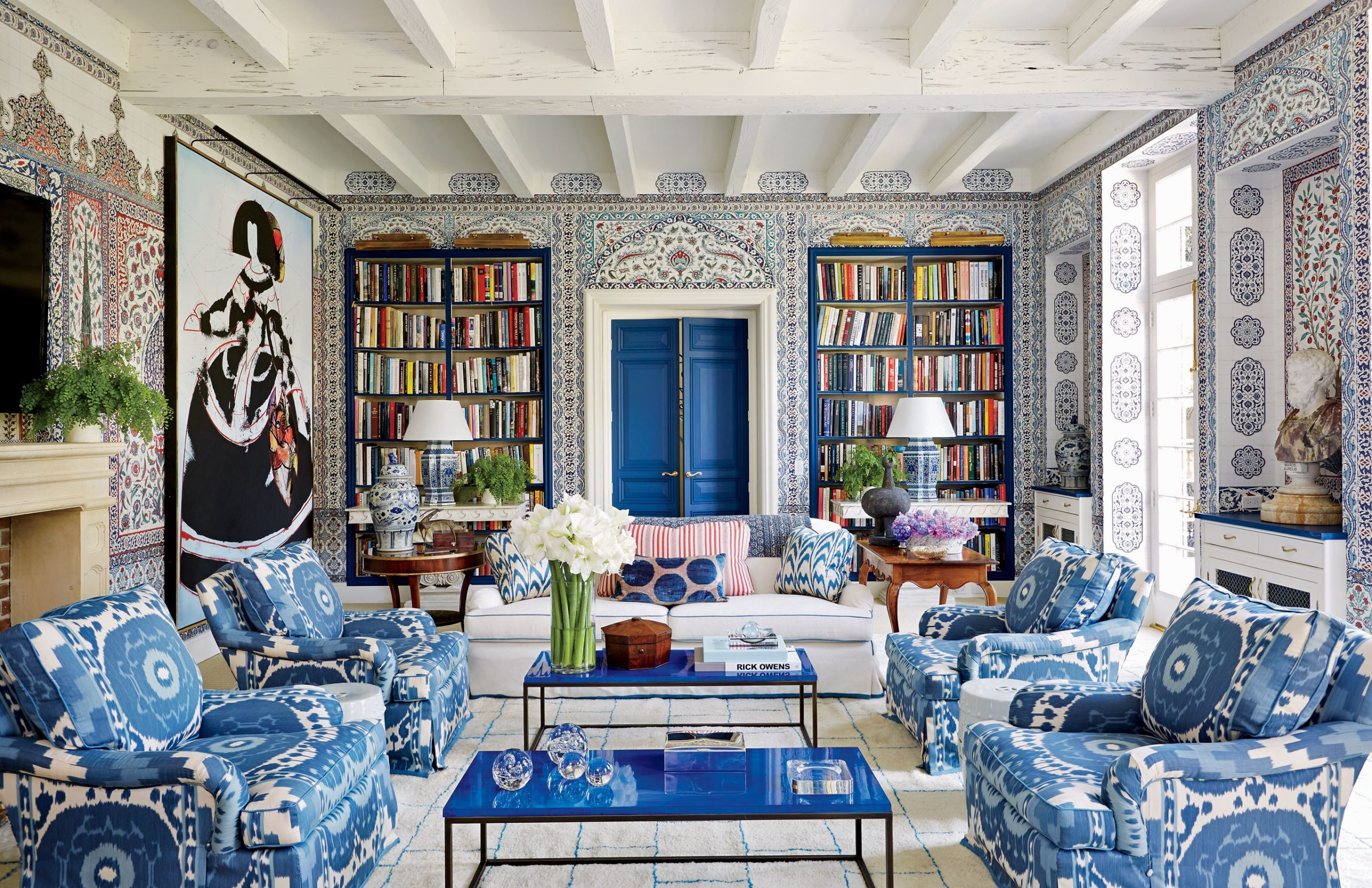Prints and patterns adorn this beautiful living room